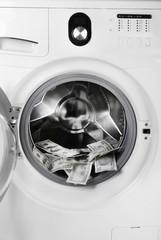 Money in washing machine, closeup view
