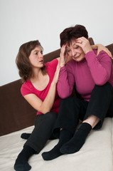 Big problems - daughter comforts senior mother