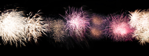 Panorama of beautiful colorful holiday fireworks