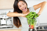 Vegetable smoothie woman making green smoothies