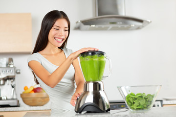 Vegetable smoothie woman blending green smoothies