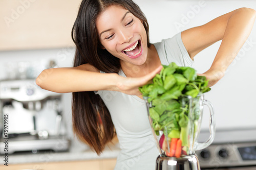 Vegetable smoothie woman making green smoothies - 75979905