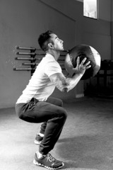 man doing ball slams exercise - crossfit workout.