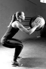 woman doing ball slams exercise - crossfit workout.
