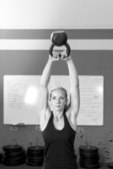 woman exercising with kettlebell - crossfit workout.