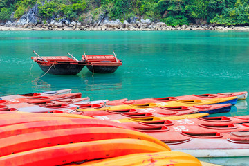 Colourful kayaks and boats on tropical island