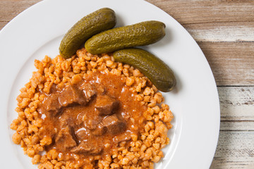 Hungarian traditional stew with egg barley and cucumber