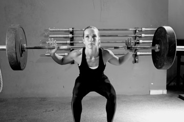 woman on a weightlifting session - crossfit workout.