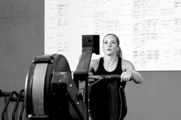 woman on rowing machine - crossfit workout.