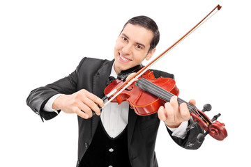 Cheerful young musician playing a violin