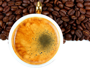 Cup of fragrant and delicious coffee and coffee beans.