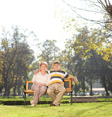 Mature couple relaxing in a park on beautiful day