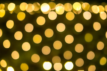 Yellow and orange holiday festive bokeh. Abstract background