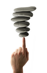 piles of stones balanced on a finger