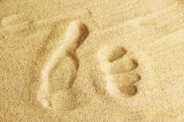 Hand prints in sand as nice summer background