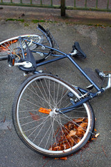 A bicycle with a buckled wheel from vandalism