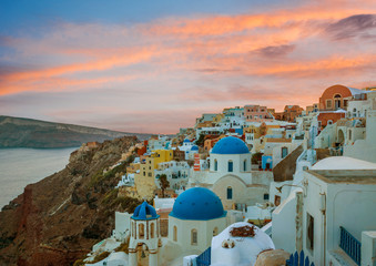 Churches of Oia village during beautiful sunset, Santorini