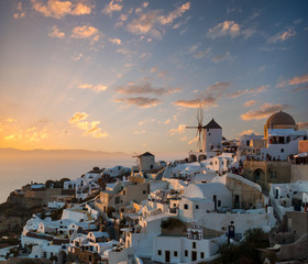 Dramatic sunset over the windmills of Oia village, Santorini