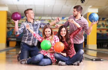 Portrait of friends in bowling club