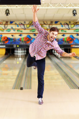 Young man have fun in bowling club