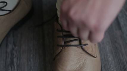 Man trying leather shoelaces