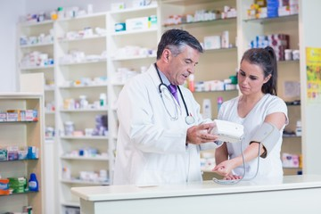 Pharmacist showing patient her blood pressure reading