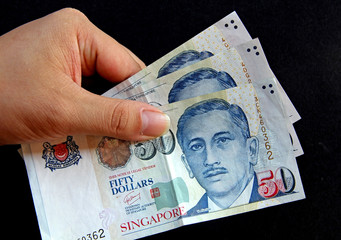Singapore Dollars banknote money in hand