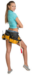 Pretty girl in shorts, shirt and tool belt with tools. Full