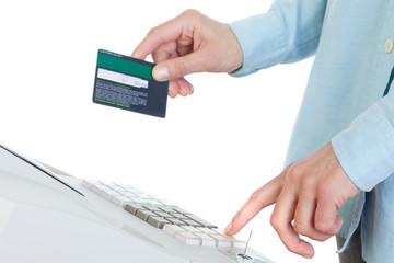 Cashier Holding Credit Card in Cash Register