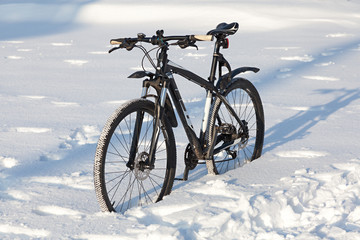 Bicycle on the street covered with snow