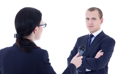 female reporter with microphone taking interview and business ma