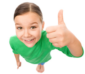 Little girl is showing thumb up gesture
