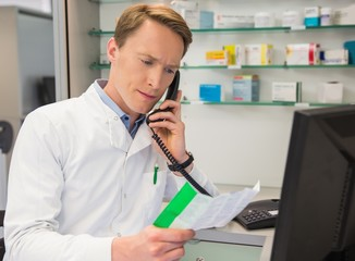 Serious pharmacist on the phone