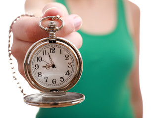 Silver pocket clock in hand close-up