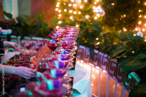 Plexiglas Cocktail Line of different colored cocktails with smoke on a party
