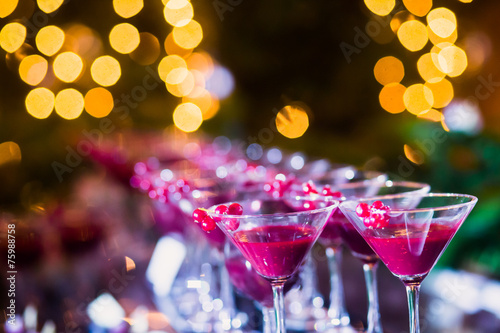 Tuinposter Alcohol Line of different colored cocktails with smoke on a party
