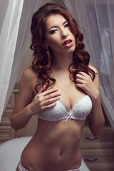 Young beautiful woman in lingerie: lace white  bra, panties.  Fa