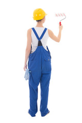 back view of woman painter in workwear with paintbrush isolated