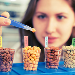 girl in the laboratory of food quality tests  legumes grain