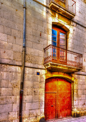 the door of an old building at Figueres town in Spain. HDR