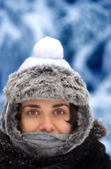 Young woman with snowball on her head