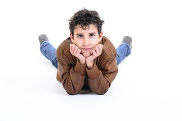 Portrait of smiling boy lying down.