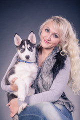 woman with a husky puppy