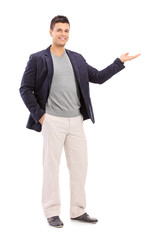 Cheerful young man gesturing with his hand