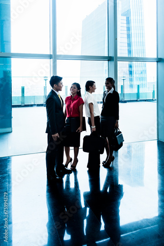 Leinwandbild Motiv Group of business people standing in lobby or hall