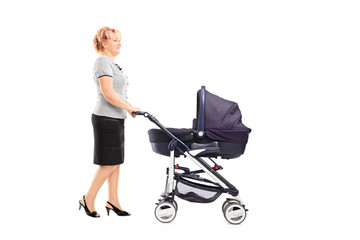 Mature woman pushing a baby stroller