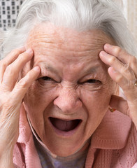Closeup portrait of scared old woman