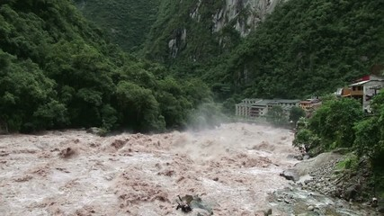 Raging torrents of the Urubamba River in full flood as it passes