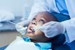 Leinwanddruck Bild - Close up of boy having his teeth examined
