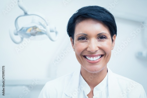 Close up portrait of female dentist - 75995775